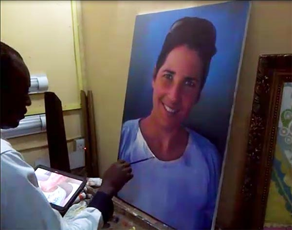 Artist Ayeola Ayodeji Abiodun making the portrait painting drawing wall art of Gij kinds wife